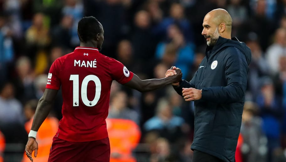 LIVERPOOL, ENGLAND - OCTOBER 07: Sadio Mane of Liverpool and Pep Guardiola the head coach / manager of Manchester City  during the Premier League match between Liverpool FC and Manchester City at Anfield on October 7, 2018 in Liverpool, United Kingdom. (Photo by Robbie Jay Barratt - AMA/Getty Images)