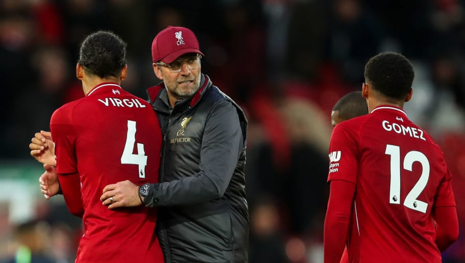 LIVERPOOL, ENGLAND - OCTOBER 07: Virgil van Dijk of Liverpool and Jurgen Klopp manager / head coach of Liverpool at full time during the Premier League match between Liverpool FC and Manchester City at Anfield on October 7, 2018 in Liverpool, United Kingdom. (Photo by Robbie Jay Barratt - AMA/Getty Images)