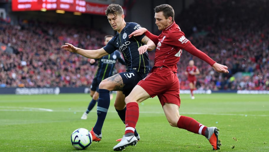 LIVERPOOL, ENGLAND - OCTOBER 07: Andy Robertson of Liverpool battles for possession with John Stones of Manchester City during the Premier League match between Liverpool FC and Manchester City at Anfield on October 7, 2018 in Liverpool, United Kingdom.  (Photo by Laurence Griffiths/Getty Images)