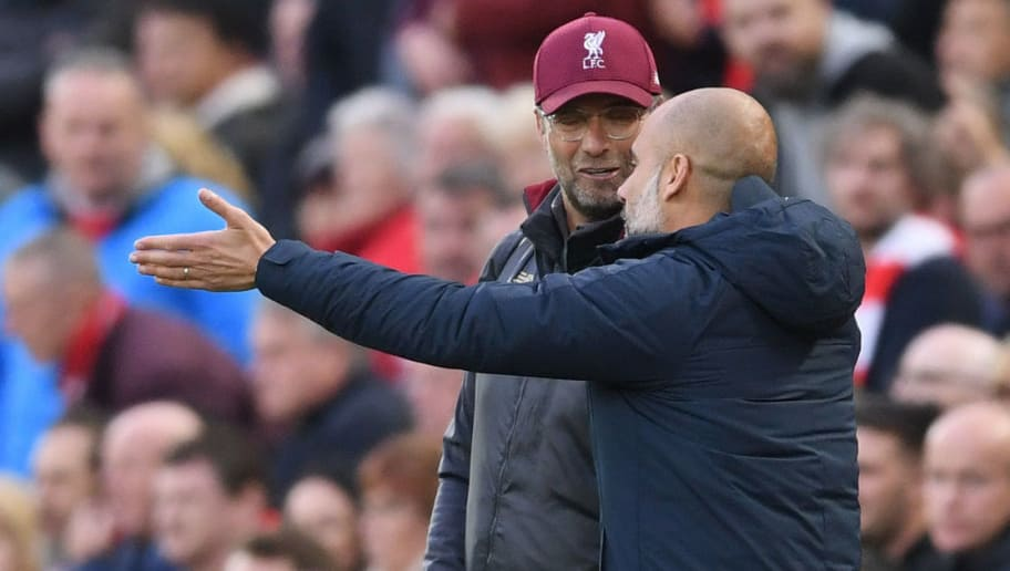 LIVERPOOL, ENGLAND - OCTOBER 07:  Jurgen Klopp, Manager of Liverpool talks with Josep Guardiola, Manager of Manchester City during the Premier League match between Liverpool FC and Manchester City at Anfield on October 7, 2018 in Liverpool, United Kingdom.  (Photo by Laurence Griffiths/Getty Images)