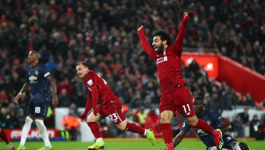 LIVERPOOL, ENGLAND - DECEMBER 16: Mohamed Salah of Liverpool celebrates his teams third goal scored by team mate Xherdan Shaqiri (23) during the Premier League match between Liverpool FC and Manchester United at Anfield on December 16, 2018 in Liverpool, United Kingdom. (Photo by Clive Brunskill/Getty Images)