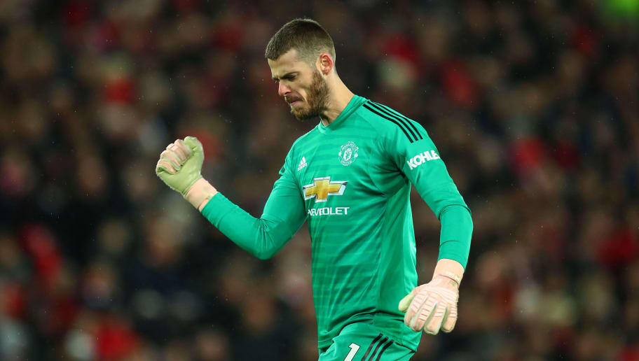 LIVERPOOL, ENGLAND - DECEMBER 16: David de Gea of Manchester United celebrates after his team equalised to make it 1-1 during the Premier League match between Liverpool FC and Manchester United at Anfield on December 16, 2018 in Liverpool, United Kingdom. (Photo by Robbie Jay Barratt - AMA/Getty Images)
