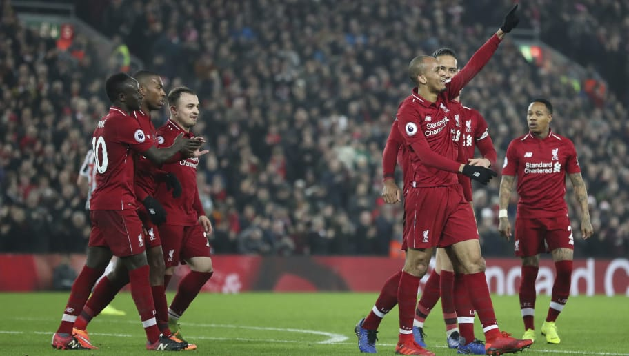 LIVERPOOL, ENGLAND - DECEMBER 26: Fabinho of Liverpool celebrates with his team mates after scoring a goal to make it 4-0 during the Premier League match between Liverpool FC and Newcastle United at Anfield on December 26, 2018 in Liverpool, United Kingdom. (Photo by James Baylis - AMA/Getty Images)