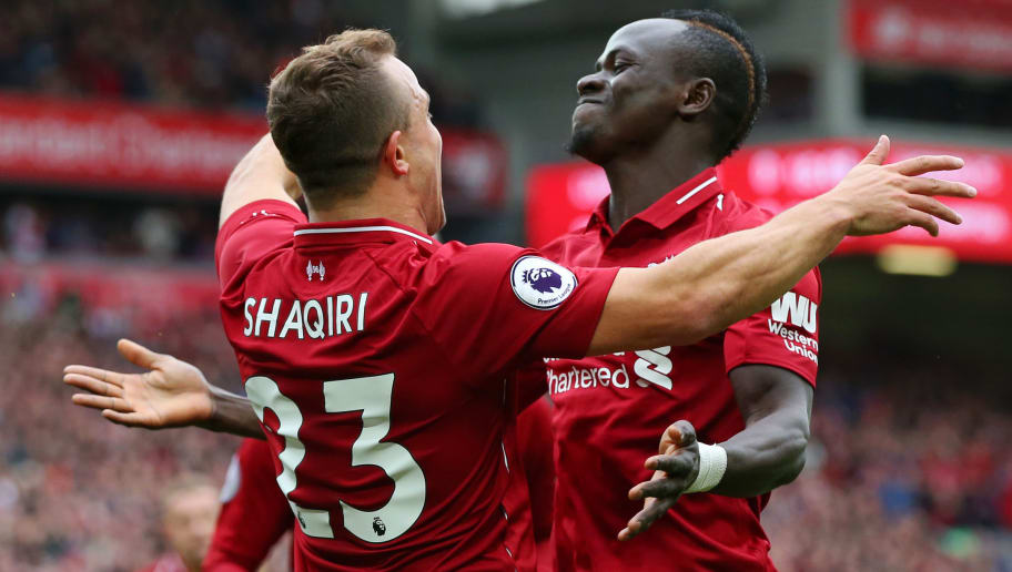 LIVERPOOL, ENGLAND - SEPTEMBER 22:  Xherdan Shaqiri of Liverpool celebrates with teammte Sadio Mane after he provides the assist for Liverpool's first goal, an own goal by Wesley Hoedt of Southampton during the Premier League match between Liverpool FC and Southampton FC at Anfield on September 22, 2018 in Liverpool, United Kingdom.  (Photo by Alex Livesey/Getty Images)