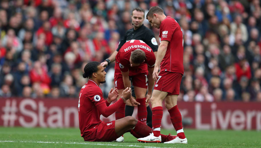 LIVERPOOL, ENGLAND - SEPTEMBER 22: Virgil van Dijk of Liverpool is injured as teammates Jordan Henderson of Liverpool and James Milner of Liverpool look on concerned during the Premier League match between Liverpool FC and Southampton FC at Anfield on September 22, 2018 in Liverpool, United Kingdom. (Photo by James Williamson - AMA/Getty Images)