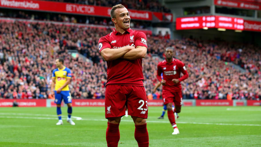 LIVERPOOL, ENGLAND - SEPTEMBER 22:  Xherdan Shaqiri of Liverpool celebrates after he provides the assist for Liverpool's first goal, an own goal by Wesley Hoedt of Southampton during the Premier League match between Liverpool FC and Southampton FC at Anfield on September 22, 2018 in Liverpool, United Kingdom.  (Photo by Alex Livesey/Getty Images)