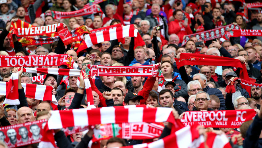 LIVERPOOL, ENGLAND - SEPTEMBER 22:  Liverpool fans sign you will never walk alone prior to the Premier League match between Liverpool FC and Southampton FC at Anfield on September 22, 2018 in Liverpool, United Kingdom.  (Photo by Alex Livesey/Getty Images)