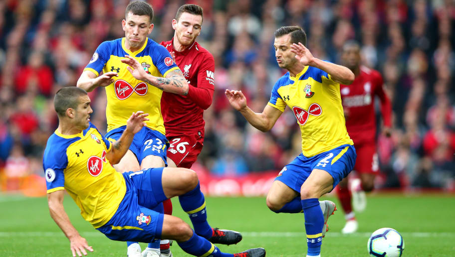 LIVERPOOL, ENGLAND - SEPTEMBER 22:  Andy Robertson of Liverpool is challenged by Pierre-Emile Hojbjerg of Southampton, Oriol Romeu of Southampton, and Cedric Soares of Southampton during the Premier League match between Liverpool FC and Southampton FC at Anfield on September 22, 2018 in Liverpool, United Kingdom.  (Photo by Alex Livesey/Getty Images)