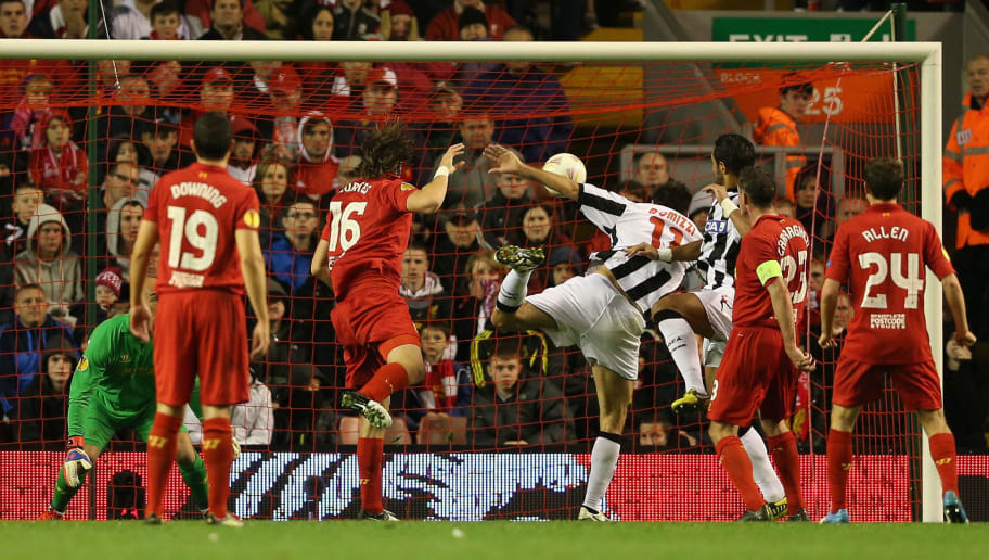 LIVERPOOL, ENGLAND - OCTOBER 04:  Sebastian Coates of Liverpool scores an own goal during the UEFA Europa League Group A match between Liverpool and Udinese at Anfield on October 4, 2012 in Liverpool, England.  (Photo by Clive Brunskill/Getty Images)