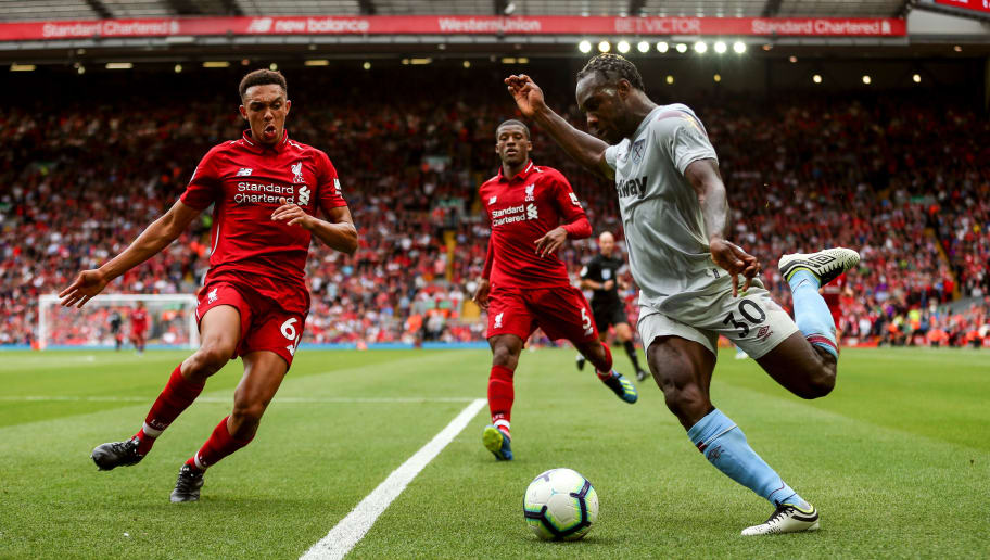 LIVERPOOL, ENGLAND - AUGUST 12: Trent Alexander-Arnold of Liverpool and Michail Antonio of West Ham United during the Premier League match between Liverpool FC and West Ham United at Anfield on August 12, 2018 in Liverpool, United Kingdom. (Photo by Robbie Jay Barratt - AMA/Getty Images)
