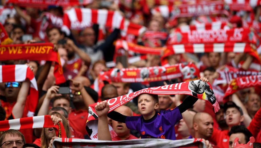 LIVERPOOL, ENGLAND - AUGUST 12:  Fans look on, showing support during the Premier League match between Liverpool FC and West Ham United at Anfield on August 12, 2018 in Liverpool, United Kingdom.  (Photo by Laurence Griffiths/Getty Images)
