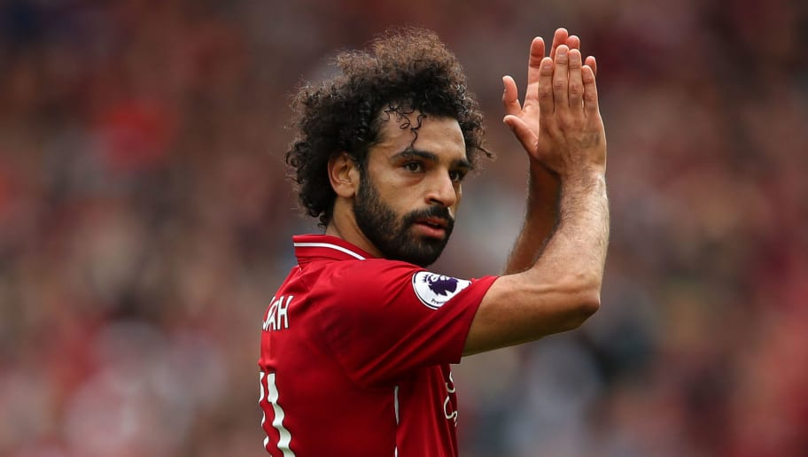 LIVERPOOL, ENGLAND - AUGUST 12: Mohamed Salah of Liverpool applauds during the Premier League match between Liverpool FC and West Ham United at Anfield on August 12, 2018 in Liverpool, United Kingdom. (Photo by Robbie Jay Barratt - AMA/Getty Images)
