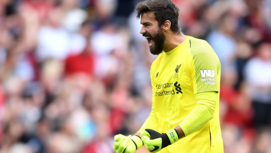 LIVERPOOL, ENGLAND - AUGUST 12:  Alisson of Liverpool celebrates his team's second goal, scored by Sadio Mane (not pictured) during the Premier League match between Liverpool FC and West Ham United at Anfield on August 12, 2018 in Liverpool, United Kingdom.  (Photo by Laurence Griffiths/Getty Images)