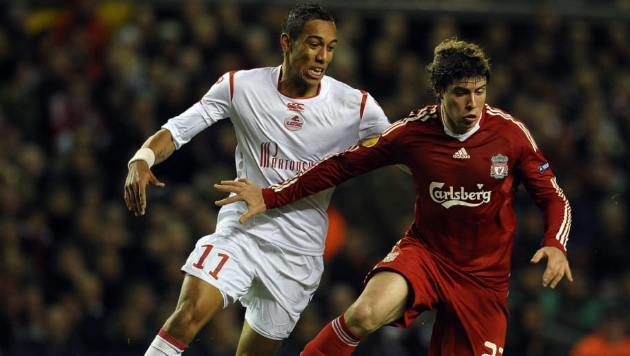 Liverpool's Argentinian defender Emiliano Insua (R) is challenged by Lille's Gabonese forward Pierre Aubameyang during their UEFA Europa League football match against Lille at Anfield in Liverpool, north-west England, on March 18, 2010.  AFP PHOTO/PAUL ELLIS (Photo credit should read PAUL ELLIS/AFP/Getty Images)