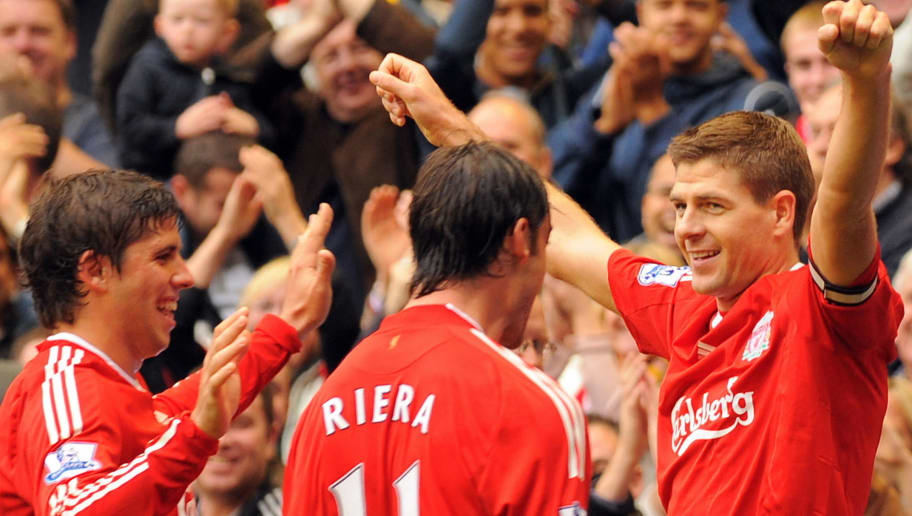 Liverpool's English midfielder Steven Gerrard (R) celebrates scoring with team-mates, Argentine Emiliano Insua (L) and Spanish player Albert Riera (C) during the English Premier League football match between Liverpool and Hull City at Anfield in Liverpool, north-west England on September 26, 2009. AFP PHOTO/PAUL ELLIS - FOR EDITORIAL USE ONLY Additional licence required for any commercial/promotional use or use on TV or internet (except identical online version of newspaper) of Premier League/Football League photos. Tel DataCo +44 207 2981656. Do not alter/modify photo. (Photo credit should read PAUL ELLIS/AFP/Getty Images)