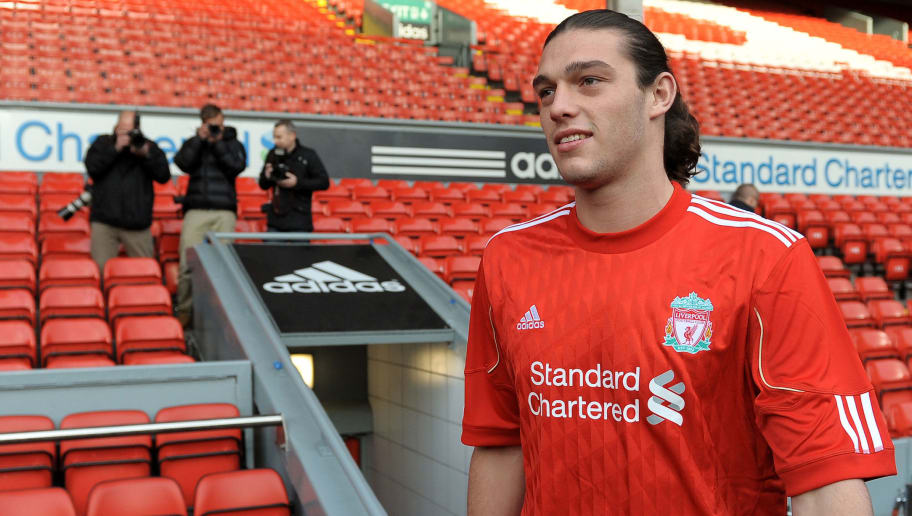 Liverpool's new signing English striker Andy Carroll arrives for a photocall at Anfield, Liverpool, northwest England, on February 3, 2011. Liverpool manager Kenny Dalglish promised more to come from Luis Suarez after revealing the Uruguay striker had not even trained with his new side before marking his Premier League debut with a goal. Suarez ensured Liverpool supporters, dejected by the loss of Fernando Torres to Chelsea on Monday, had a new hero after coming off the substitutes' bench to score in the 2-0 victory over Stoke at Anfield on Wednesday. AFP PHOTO/ ANDREW YATESRESTRICTED TO EDITORIAL USE Additional licence required for any commercial/promotional use or use on TV or internet (except identical online version of newspaper) of Premier League/Football League photos. Tel DataCo +44 207 2981656. Do not alter/modify photo . (Photo credit should read ANDREW YATES/AFP/Getty Images)
