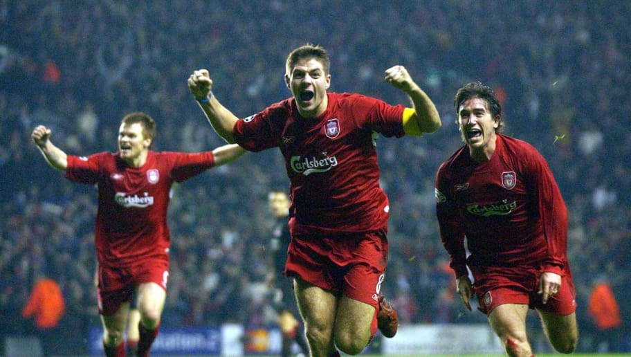 LIVERPOOL, UNITED KINGDOM:  Liverpool's Steven Gerard (c) flanked by John Arne Riise (l) and Harry Kew ll (r) celebrates scoring to make it 3-1 against Olympiakos CFP during their UEFA Champions League clash at Anfield, Liverpool08 December 2004. AFP photo Paul Barker     (Photo credit should read PAUL BARKER/AFP/Getty Images)