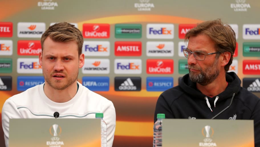 LIVERPOOL, ENGLAND - APRIL 13:  Jurgen Klopp, Manager of Liverpool looks on as Simon Mignolet of Liverpool addresses the media during a press conference ahead of the UEFA Europa League quarter final between Liverpool and Borussia Dortmund at Melwood Training Ground on April 13, 2016 in Liverpool, England.  (Photo by Dave Thompson/Getty Images)