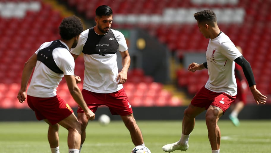 LIVERPOOL, ENGLAND - MAY 21:  Mohamed Salah, Emre Can and Roberto Firmino of Liverpool pass the ball during a training session at Anfield on May 21, 2018 in Liverpool, England.  (Photo by Jan Kruger/Getty Images)