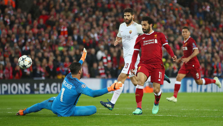 LIVERPOOL, ENGLAND - APRIL 24:  Mohamed Salah of Liverpool scores his sides second goal past Alisson Becker of AS Roma during the UEFA Champions League Semi Final First Leg match between Liverpool and A.S. Roma at Anfield on April 24, 2018 in Liverpool, United Kingdom.  (Photo by Clive Brunskill/Getty Images)
