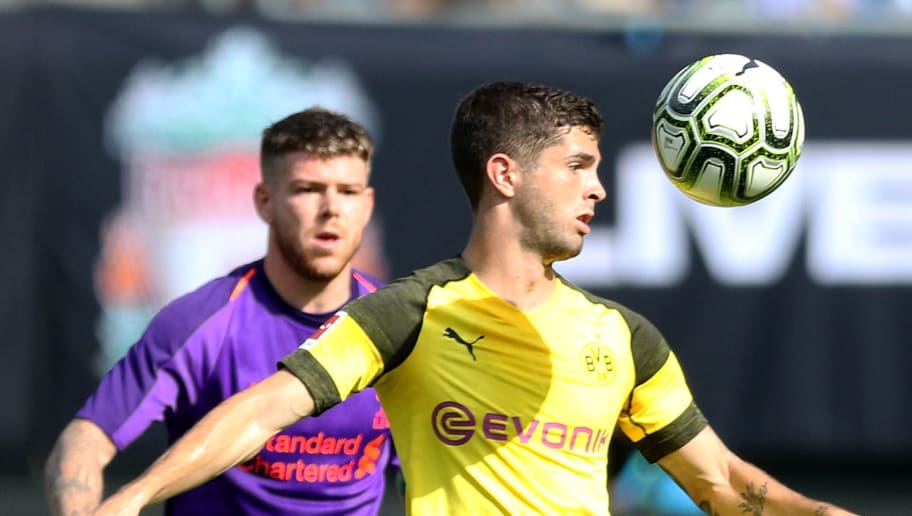 CHARLOTTE, NC - JULY 22:  Christian Pulisic #22 of Borussia Dortmund controls the ball as Alberto Moreno #18 of Liverpool watches during an International Champions Cup match at Bank of America Stadium on July 22, 2018 in Charlotte, North Carolina.  (Photo by Bob Leverone/Getty Images)