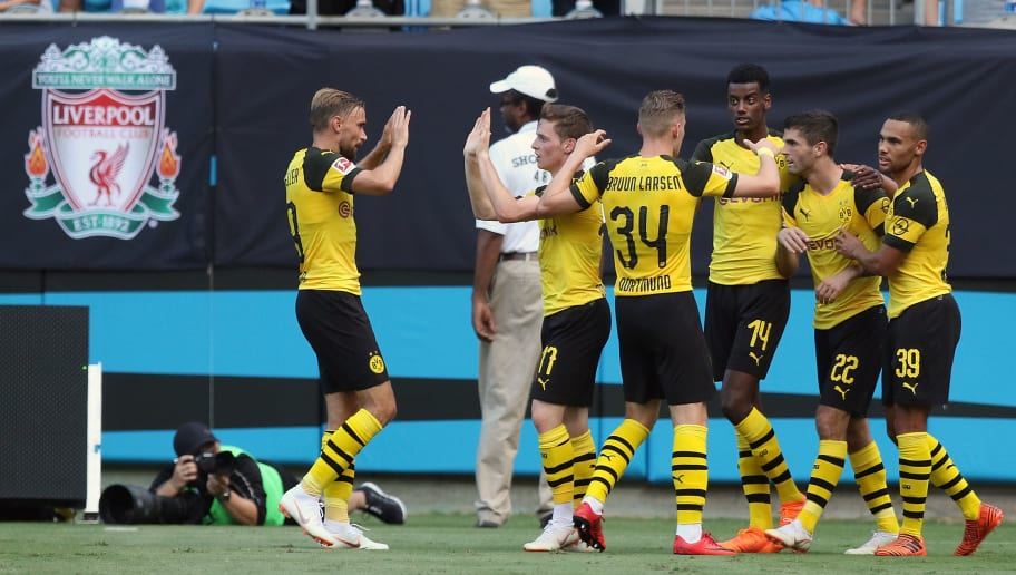 CHARLOTTE, NC - JULY 22:  Members of the Borussia Dortmund team celebrate with Christian Pulisic #22 in a 3-1 win over Liverpool during an International Champions Cup match at Bank of America Stadium on July 22, 2018 in Charlotte, North Carolina.  (Photo by Bob Leverone/Getty Images)