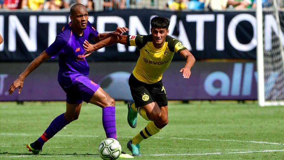 CHARLOTTE, NC - JULY 22:  Mahmoud Dahoud #19 of Borussia Dortmund competes for possession against Fabinho #3 of Liverpool in the first half during an International Champions Cup game at Bank of America Stadium on July 22, 2018 in Charlotte, North Carolina.  (Photo by Grant Halverson/International Champions Cup/Getty Images)