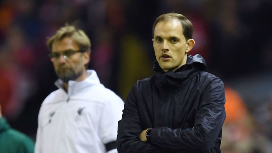 LIVERPOOL, ENGLAND - APRIL 14: (R-L) Thomas Tuchel, coach of Borussia Dortmund and Jurgen Klopp, manager of Liverpool look on during the UEFA Europa League quarter final, second leg match between Liverpool and Borussia Dortmund at Anfield on April 14, 2016 in Liverpool, United Kingdom. (Photo by Shaun Botterill/Getty Images)