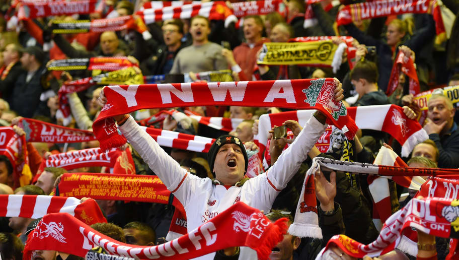 LIVERPOOL, ENGLAND - APRIL 14:  Liverpool fans cheer on their team during the UEFA Europa League quarter final, second leg match between Liverpool and Borussia Dortmund at Anfield on April 14, 2016 in Liverpool, United Kingdom.  (Photo by Shaun Botterill/Getty Images)