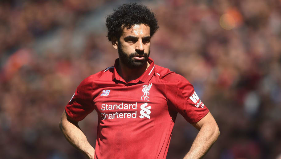 LIVERPOOL, ENGLAND - MAY 13:  Mohamed Salah of Liverpool in action during the Premier League match between Liverpool and Brighton and Hove Albion at Anfield on May 13, 2018 in Liverpool, England.  (Photo by Michael Regan/Getty Images)