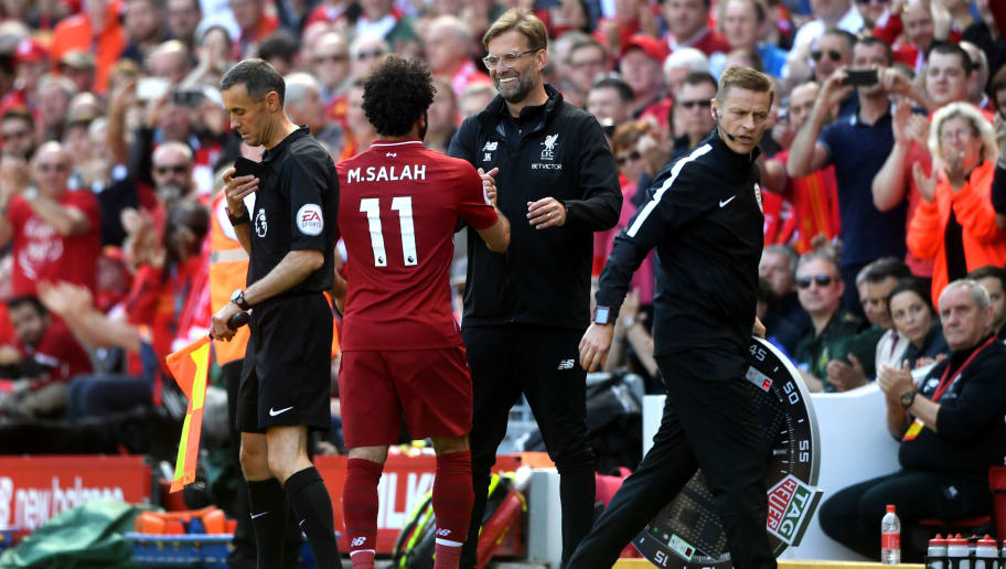 LIVERPOOL, ENGLAND - MAY 13:  Mohamed Salah of Liverpool is embraced by Jurgen Klopp, Manager of Liverpool during the Premier League match between Liverpool and Brighton and Hove Albion at Anfield on May 13, 2018 in Liverpool, England.  (Photo by Michael Regan/Getty Images)