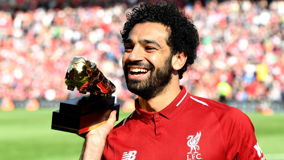 LIVERPOOL, ENGLAND - MAY 13:  Mohamed Salah of Liverpool pose for a photo with his Premier League Golden Boot Award after the Premier League match between Liverpool and Brighton and Hove Albion at Anfield on May 13, 2018 in Liverpool, England.  (Photo by Michael Regan/Getty Images)