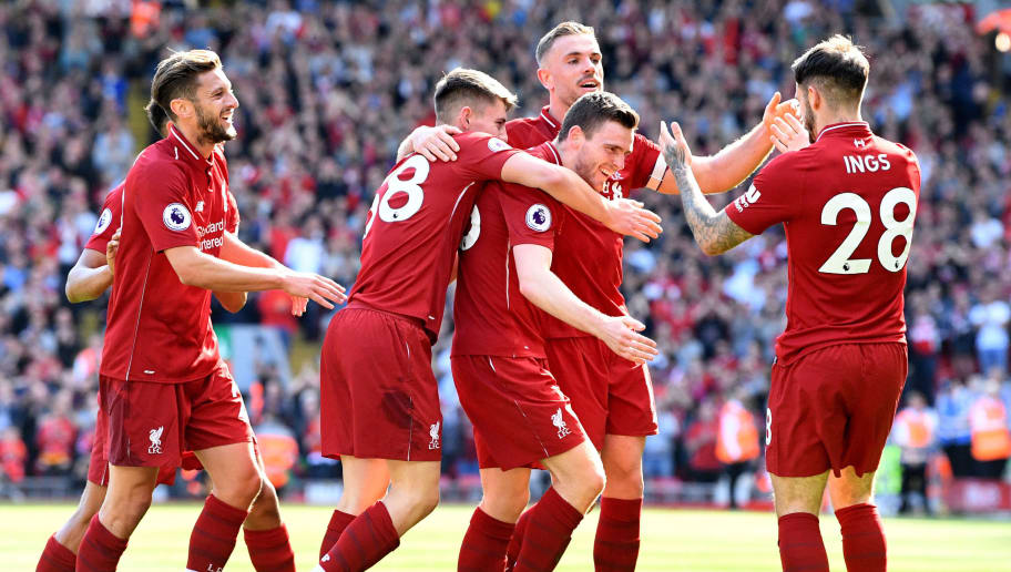 LIVERPOOL, ENGLAND - MAY 13:  Andy Robertson of Liverpool celebrates with team mates after scoring his sides fourth goal during the Premier League match between Liverpool and Brighton and Hove Albion at Anfield on May 13, 2018 in Liverpool, England.  (Photo by Michael Regan/Getty Images)