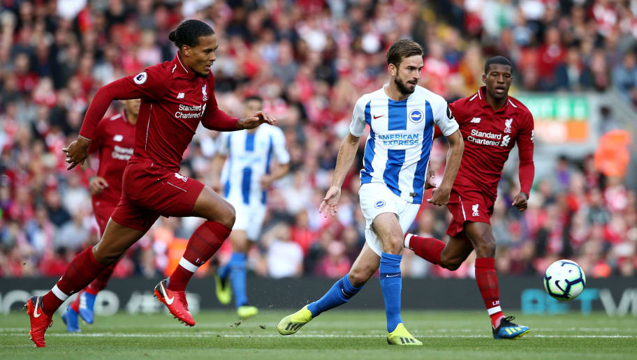 LIVERPOOL, ENGLAND - AUGUST 25:  Davy Proepper of Brighton and Hove Albion in action as Virgil van Dijk of Liverpool and Georginio Wijnaldum of Liverpool look on during the Premier League match between Liverpool FC and Brighton & Hove Albion at Anfield on August 25, 2018 in Liverpool, United Kingdom.  (Photo by Jan Kruger/Getty Images)