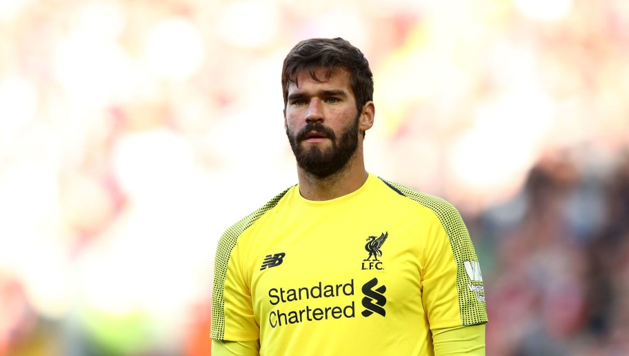 LIVERPOOL, ENGLAND - AUGUST 25:  Alisson Becker of Liverpool looks on during the Premier League match between Liverpool FC and Brighton & Hove Albion at Anfield on August 25, 2018 in Liverpool, United Kingdom. (Photo by Jan Kruger/Getty Images)