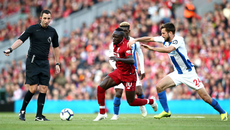 LIVERPOOL, ENGLAND - AUGUST 25:  Yves Bissouma of Brighton and Hove Albion and Davy Proepper of Brighton and Hove Albion battles for posession with Sadio Mane of Liverpool as Match Referee Chris Kavanagh looks on during the Premier League match between Liverpool FC and Brighton & Hove Albion at Anfield on August 25, 2018 in Liverpool, United Kingdom.  (Photo by Jan Kruger/Getty Images)