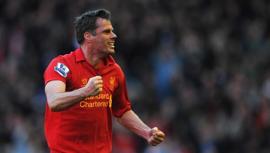 LIVERPOOL, ENGLAND - APRIL 21:  Jamie Carragher of Liverpool celebrates the equalising goal scored by Luis Suarez during the Barclays Premier League match between Liverpool and Chelsea at Anfield on April 21, 2013 in Liverpool, England.  (Photo by Michael Regan/Getty Images)