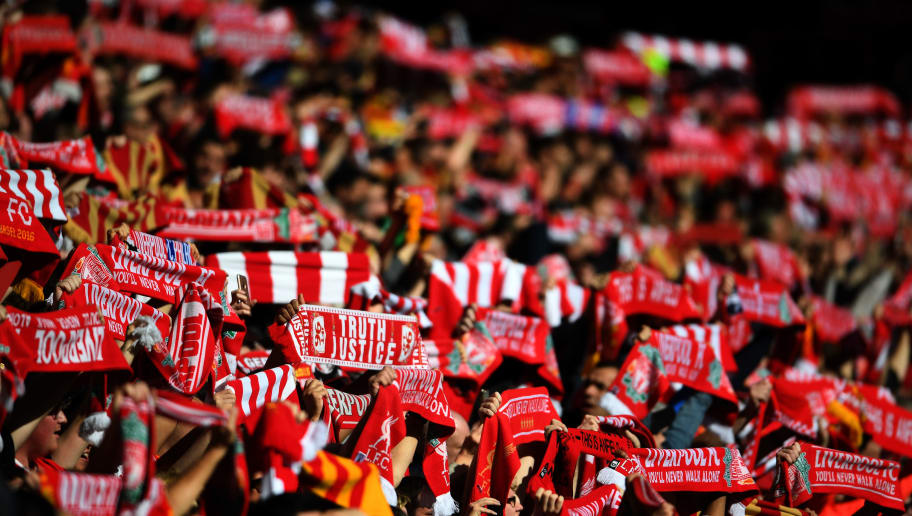 LIVERPOOL, ENGLAND - APRIL 23:  Liverpool fans raise their scarves during the Premier League match between Liverpool and Crystal Palace at Anfield on April 23, 2017 in Liverpool, England.  (Photo by Laurence Griffiths/Getty Images)