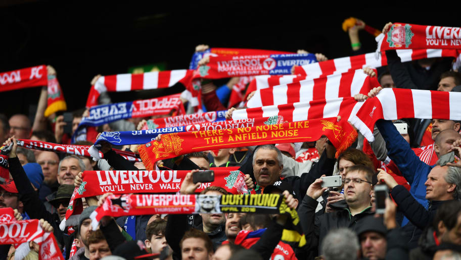 LIVERPOOL, ENGLAND - APRIL 01:  Liverpool fans display their scarfs during the Premier League match between Liverpool and Everton at Anfield on April 1, 2017 in Liverpool, England.  (Photo by Gareth Copley/Getty Images)
