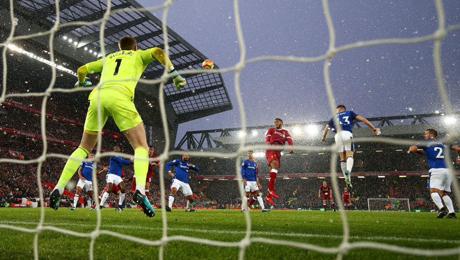 LIVERPOOL, ENGLAND - DECEMBER 10:  Joe Gomez of Liverpool misses a chance as the snow falls during the Premier League match between Liverpool and Everton at Anfield on December 10, 2017 in Liverpool, England.  (Photo by Clive Brunskill/Getty Images)