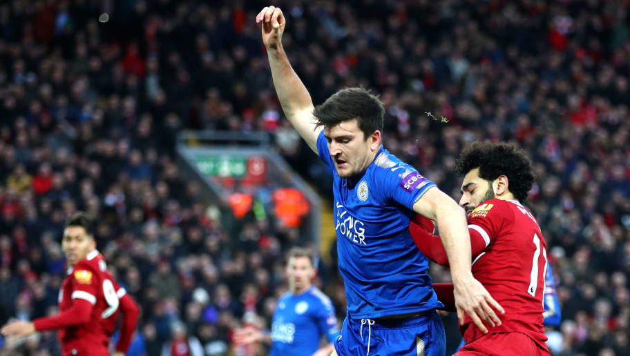 LIVERPOOL, ENGLAND - DECEMBER 30: Harry Maguire of Leicester City is challenged by Mohamed Salah of Liverpool during the Premier League match between Liverpool and Leicester City at Anfield on December 30, 2017 in Liverpool, England.  (Photo by Clive Brunskill/Getty Images)
