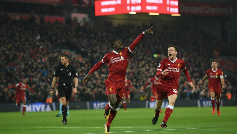 LIVERPOOL, ENGLAND - JANUARY 14:  Sadio Mane of Liverpool celebrates with team mate Andy Robertson after scoring the third Liverpool goal during during the Premier League match between Liverpool and Manchester City at Anfield on January 14, 2018 in Liverpool, England.  (Photo by Shaun Botterill/Getty Images)