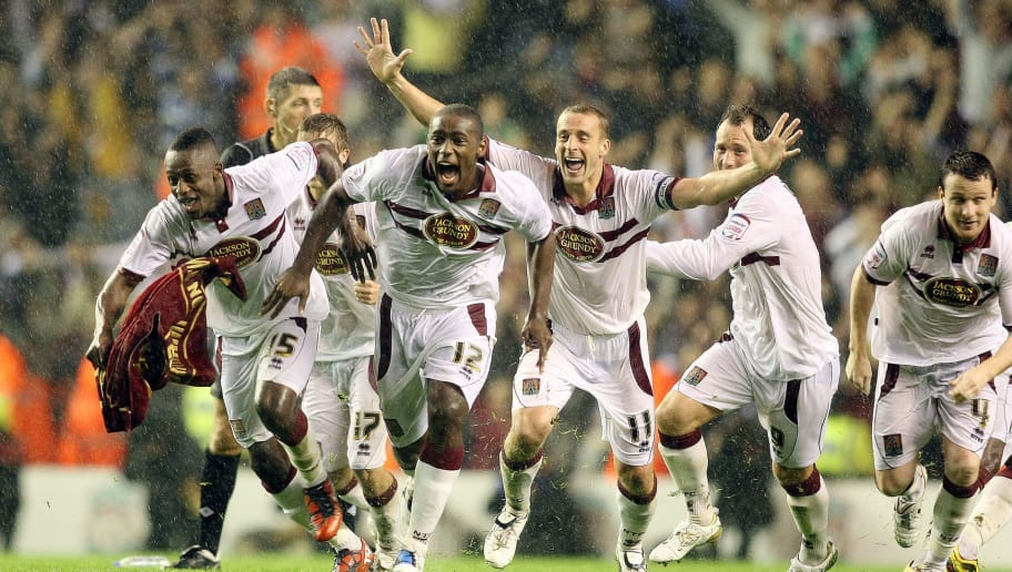 LIVERPOOL, ENGLAND - SEPTEMBER 22:  Northampton Town players celebrate victory after Abdul Osman had scored the winning penalty in the penalty shoot out during the Carling Cup Third Round match between Liverpool and Northampton Town at Anfield on September 22, 2010 in Liverpool, England. (Photo by Pete Norton/Getty Images)
