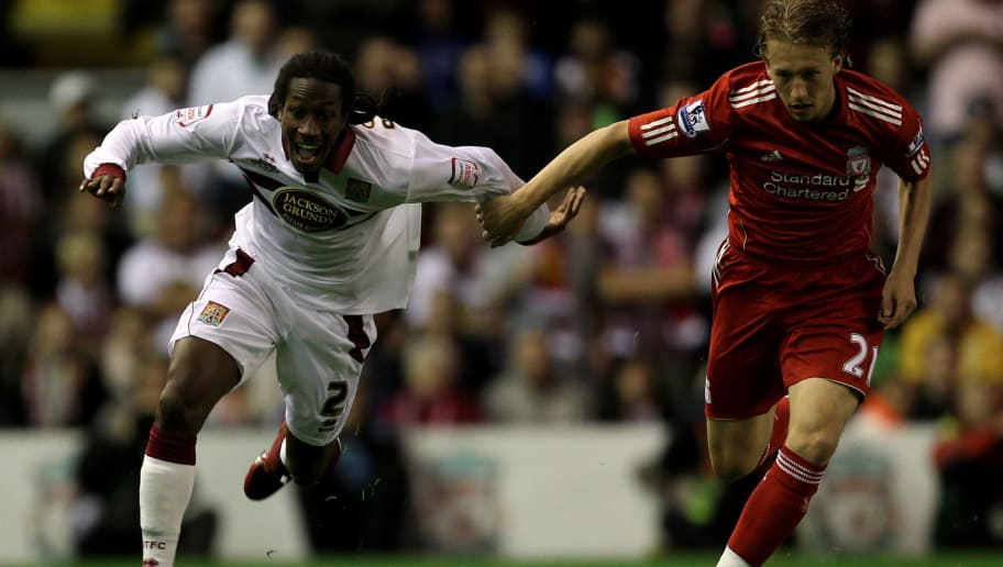 LIVERPOOL, ENGLAND - SEPTEMBER 22:  Paul Rodgers of Northampton Town is challenged by Lucas of Liverpool during the Carling Cup Third Round game between Liverpool and Northampton Town at Anfield on September 22, 2010 in Liverpool, England.  (Photo by Alex Livesey/Getty Images)