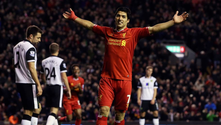 LIVERPOOL, ENGLAND - DECEMBER 4:   Luis Suarez of Liverpool celebrates setting up the fifth goal for team mate Raheem Sterling during the Barclays Premier League match between Liverpool and Norwich City at Anfield on December 4, 2013 in Liverpool, England.  (Photo by Jan Kruger/Getty Images)