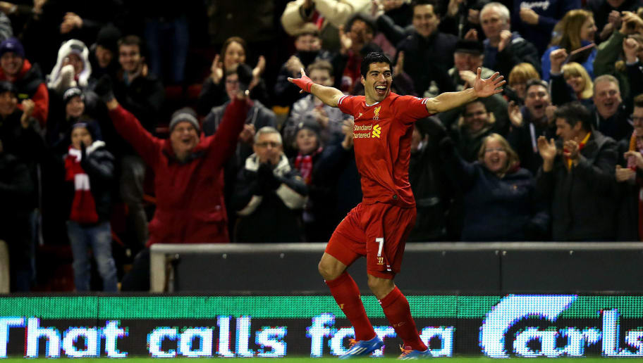 LIVERPOOL, ENGLAND - DECEMBER 4:   Luis Suarez of Liverpool celebrates his first goal from a long range effort during the Barclays Premier League match between Liverpool and Norwich City at Anfield on December 4, 2013 in Liverpool, England.  (Photo by Jan Kruger/Getty Images)