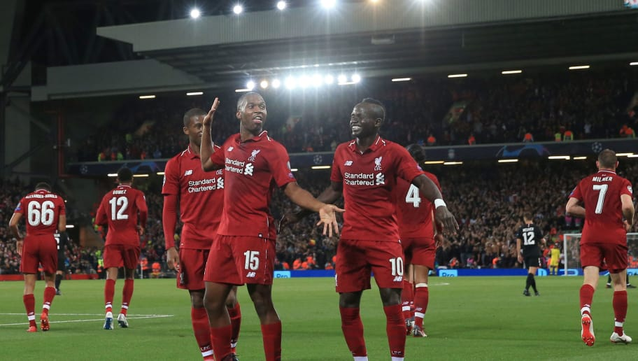 LIVERPOOL, ENGLAND - SEPTEMBER 18:  Daniel Sturridge of Liverpool celebrates scoring their 1at goal with team mates during the Group C match of the UEFA Champions League between Liverpool and Paris Saint-Germain at Anfield on September 18, 2018 in Liverpool, United Kingdom. (Photo by Marc Atkins/Getty Images)