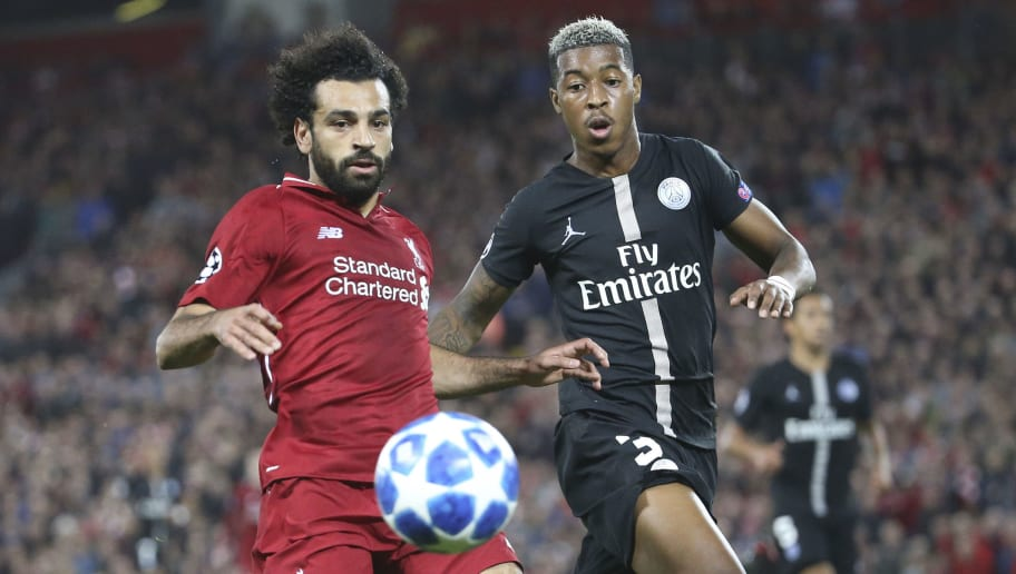 LIVERPOOL, ENGLAND - SEPTEMBER 18: Mohamed Salah of Liverpool, Presnel Kimpembe of PSG during the Group C match of the UEFA Champions League between Liverpool FC and Paris Saint-Germain (PSG) at Anfield on September 18, 2018 in Liverpool, United Kingdom. (Photo by Jean Catuffe/Getty Images)
