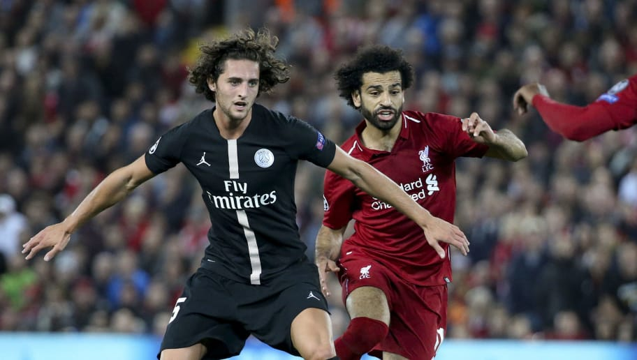 LIVERPOOL, ENGLAND - SEPTEMBER 18: Adrien Rabiot of PSG, Mohamed Salah of Liverpool during the Group C match of the UEFA Champions League between Liverpool FC and Paris Saint-Germain (PSG) at Anfield on September 18, 2018 in Liverpool, United Kingdom. (Photo by Jean Catuffe/Getty Images)