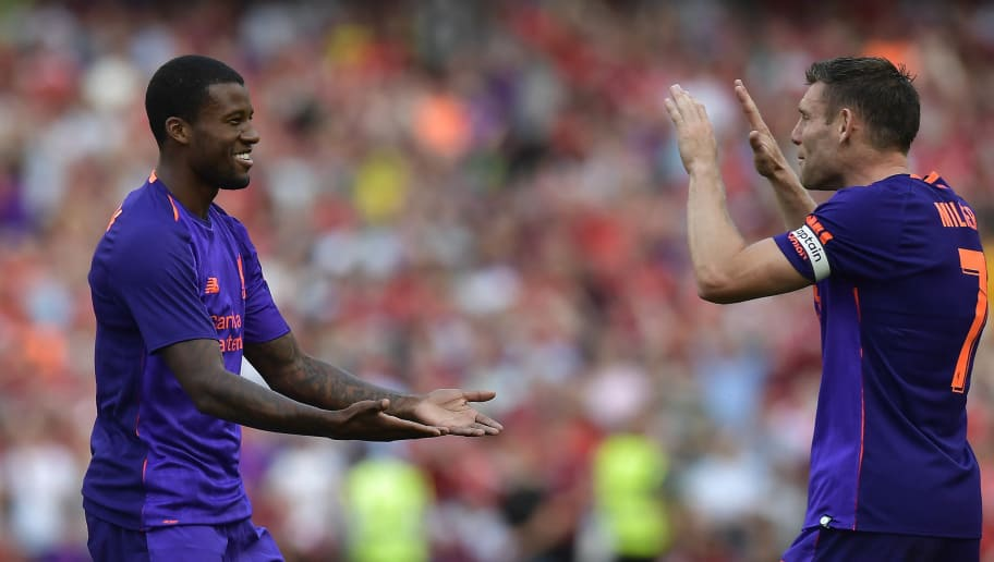 DUBLIN, IRELAND - AUGUST 04: Georginio Wijnaldum of Liverpool celebrates with team mate James Milner after scoring during the international friendly game between Liverpool and Napoli at Aviva Stadium on August 4, 2018 in Dublin, Ireland. (Photo by Charles McQuillan/Getty Images)